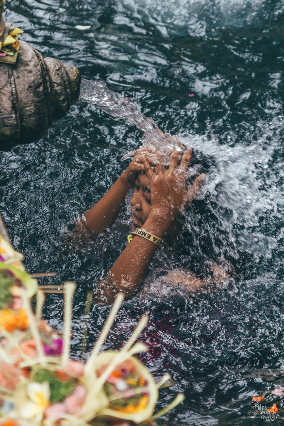 Ritual at Tirta Empul temple in Bali