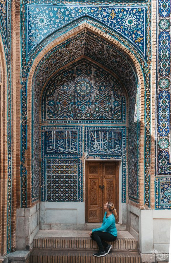 Woman next to the door to a tomb in Samarkand