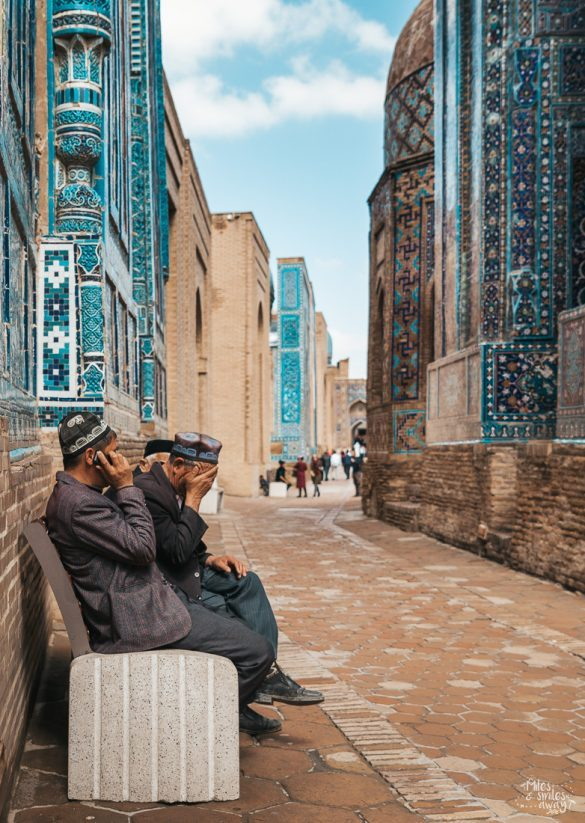 Group of men sitting on a bench in Shah i Zinda tomb in Samarkand